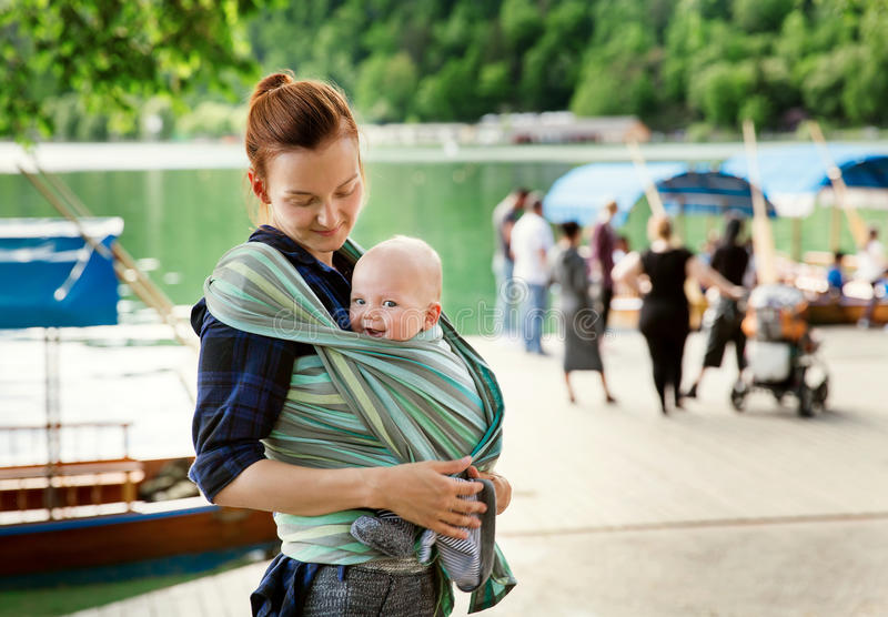 Baby and mother on nature. Near the lake Bled royalty free stock photography