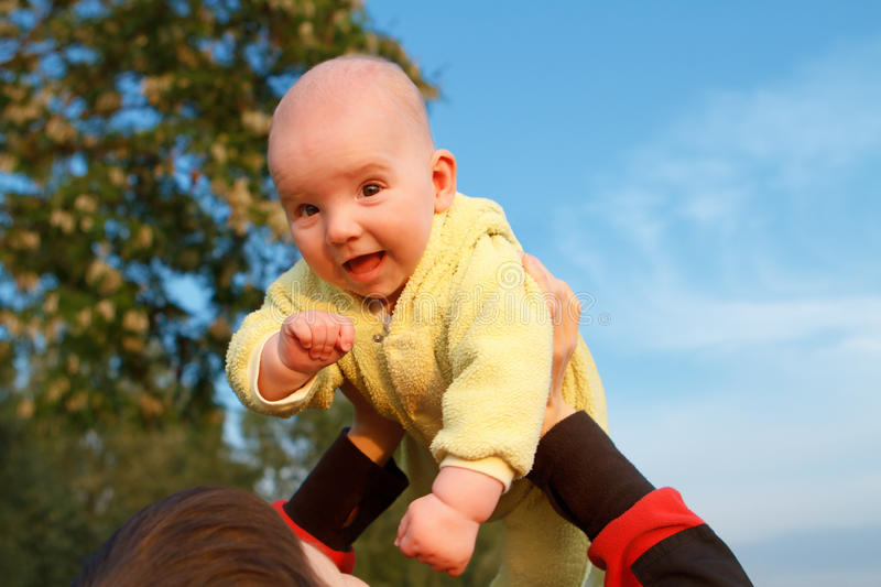 Download Baby in mother's arms stock image. Image of camera, hand - 17747211
