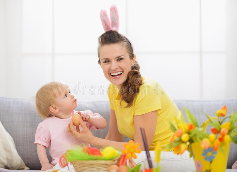 Baby and mother spending time together on Easter royalty free stock photography