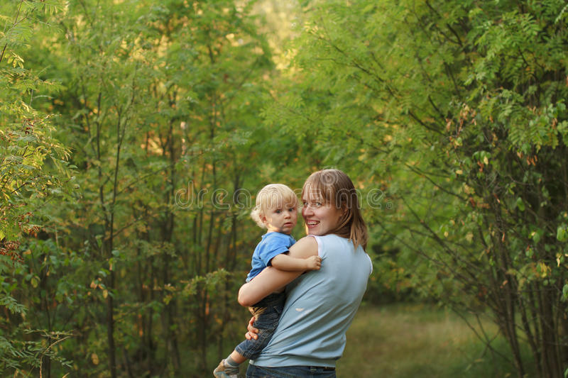 Baby with mother walk in nature stock image