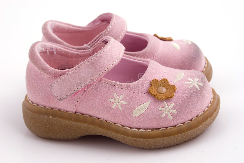 Baby needs new shoes. A set pink baby shoes royalty free stock image