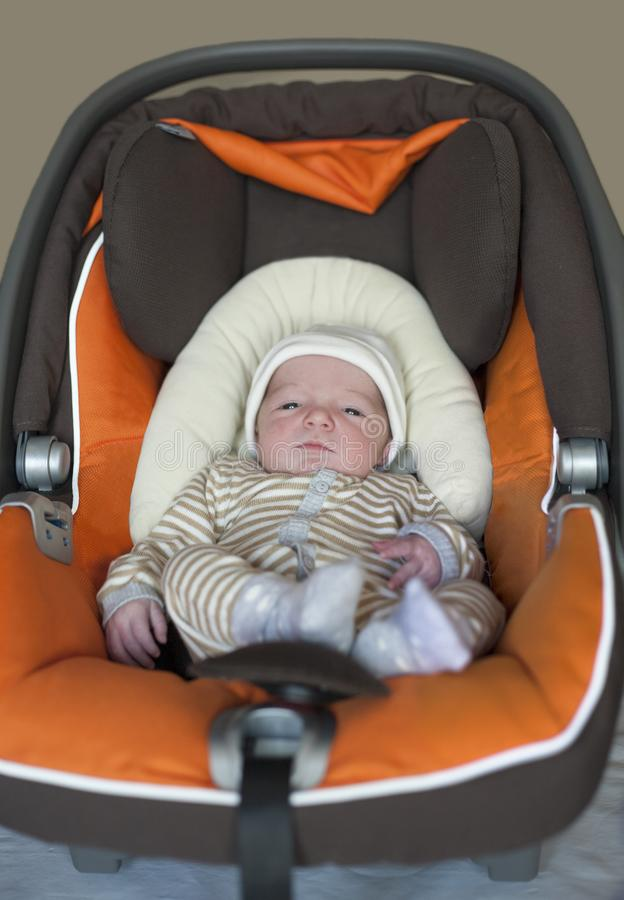 Baby newborn at i-size baby car seat type. Few days-old baby at home royalty free stock photos