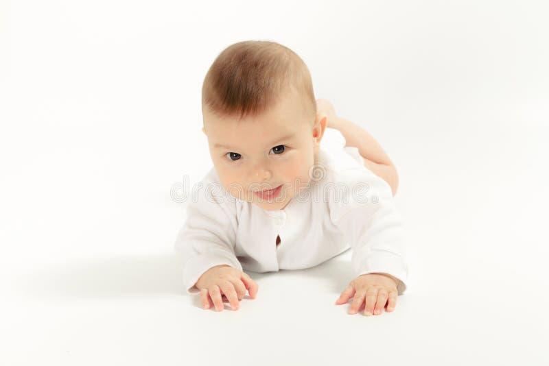 Baby newborn in the shirt closeup on white background. stock image
