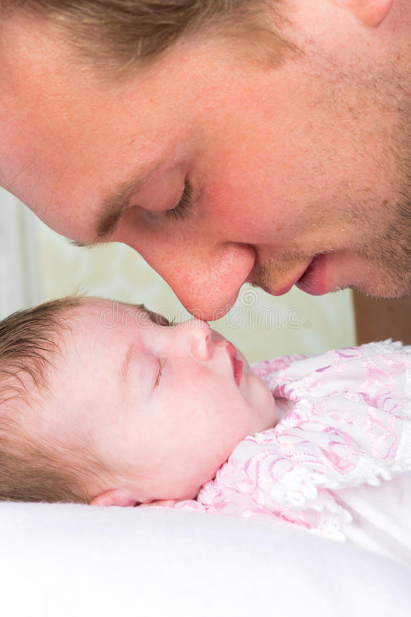 Baby nose. Tender moment between a young daddy and his baby girl stock photography