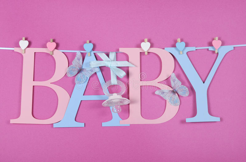 Baby nursery pink and blue letters bunting royalty free stock photography