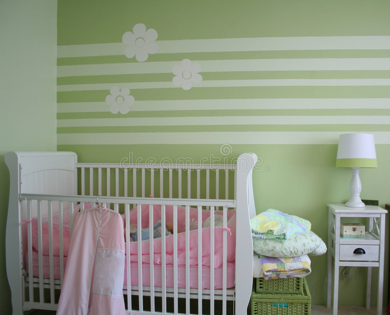 Baby nusery. Decorative baby nursery with green stripes on the wall royalty free stock photography
