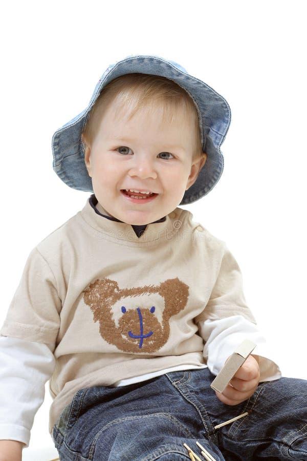 Baby op de witte achtergrond stock foto