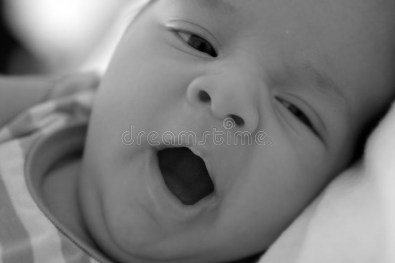 Baby with opened mouth stock images