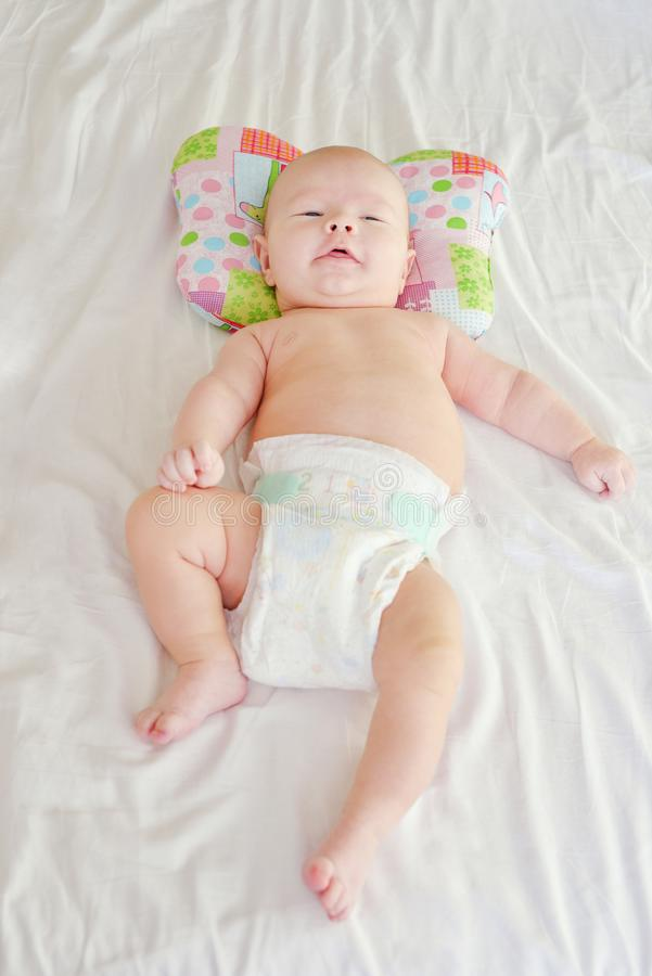 Baby   on  orthopedic pillow stock photography
