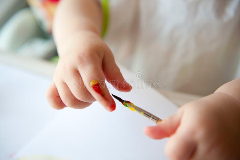 Baby painting stock photo