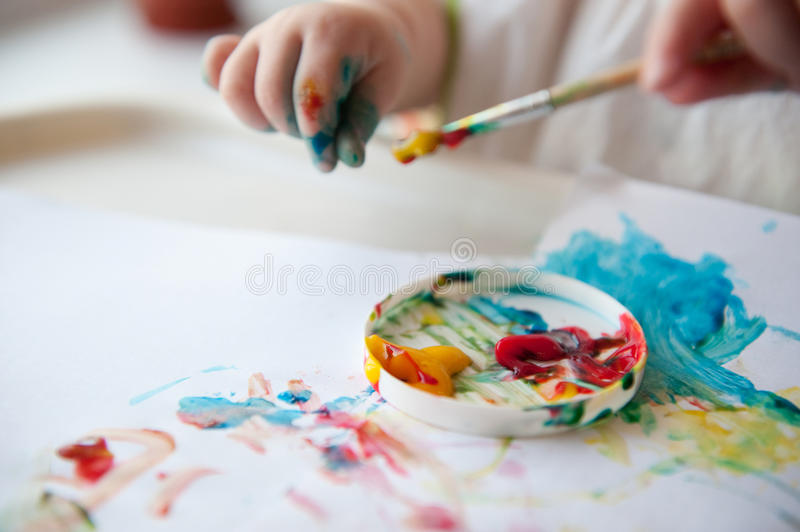 Baby painting stock photos