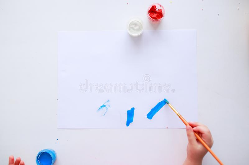 Baby painting picture with fingers or brush for mother royalty free stock image