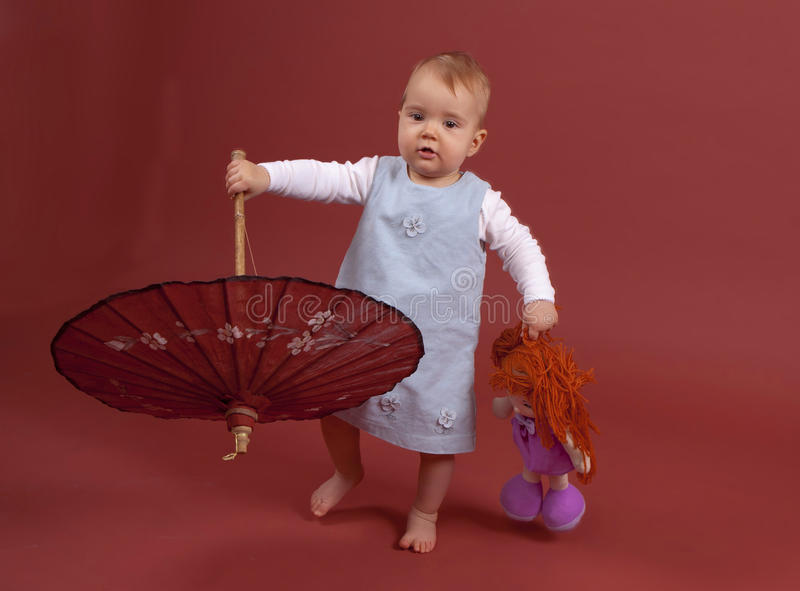 Baby with parasol royalty free stock images