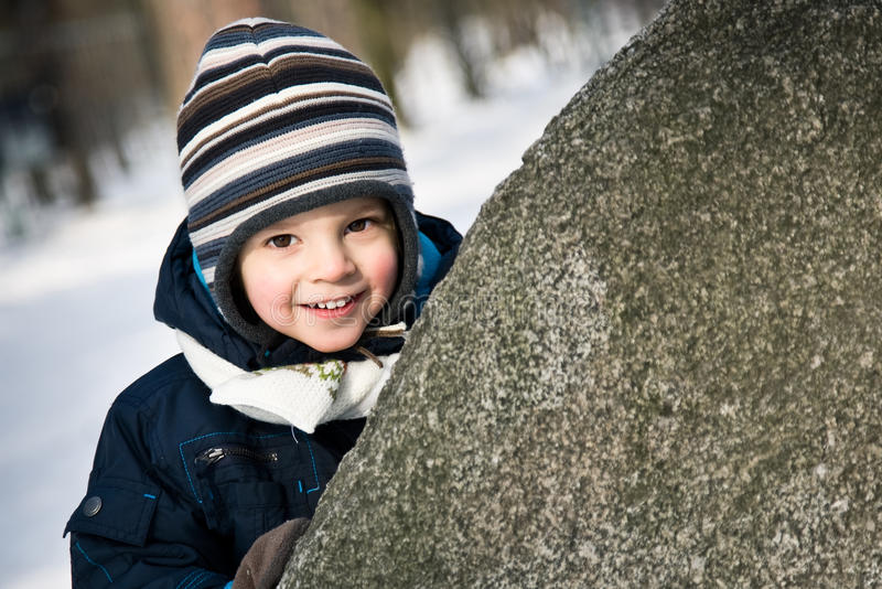 Baby peep out of the stone. Baby boy peep out of the stone stock photo