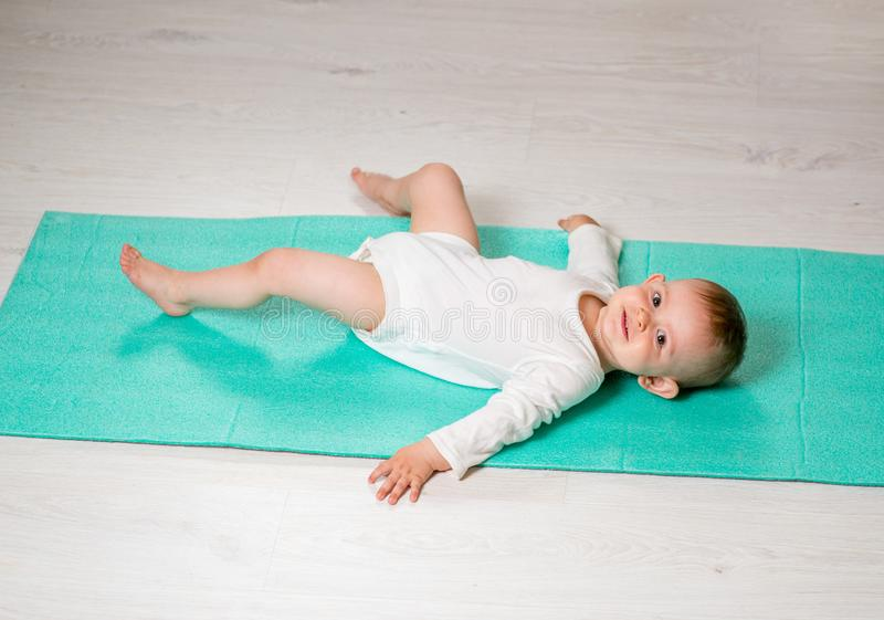 Baby is performing physical exercises royalty free stock photo