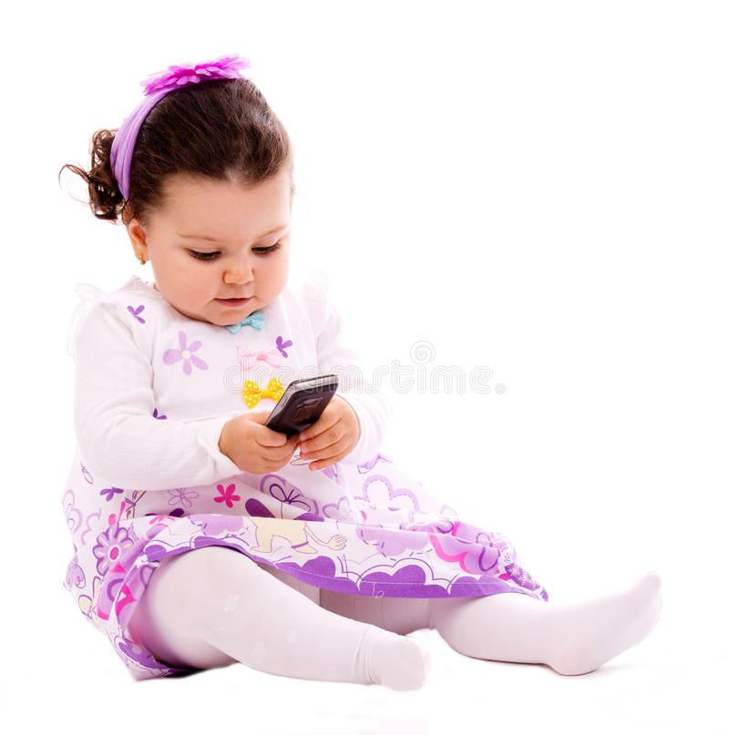 Baby with phone mobile stock images