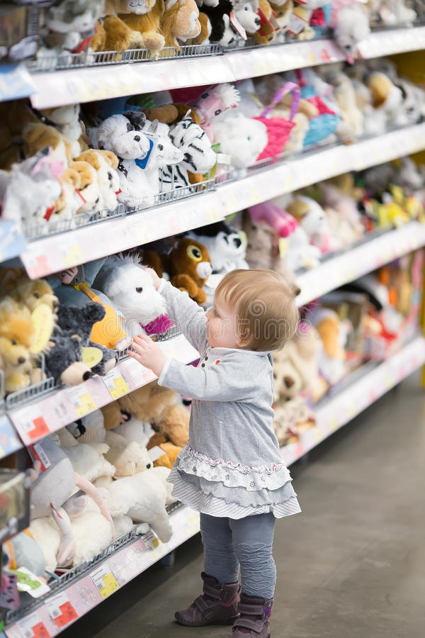 Baby picks a toy at the store royalty free stock photos