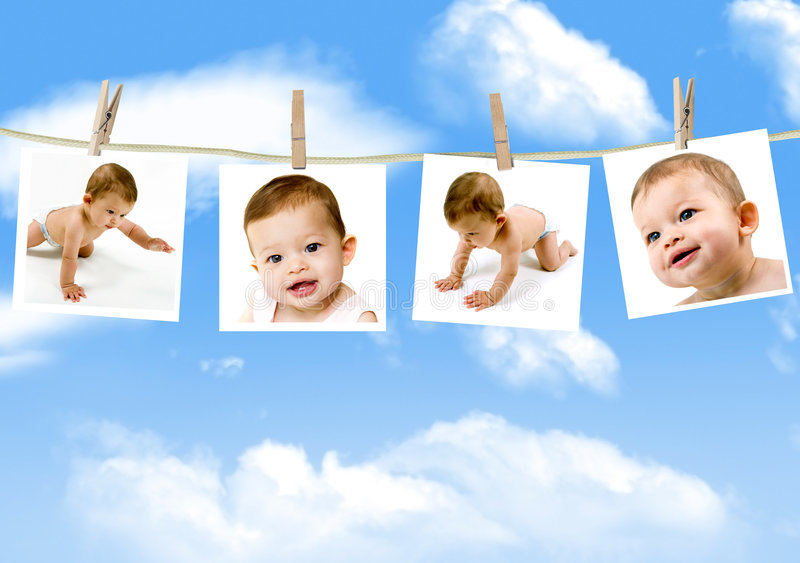 Baby pictures. Photos of an adorable baby hanging on a clothes line against a cloudy sky stock images