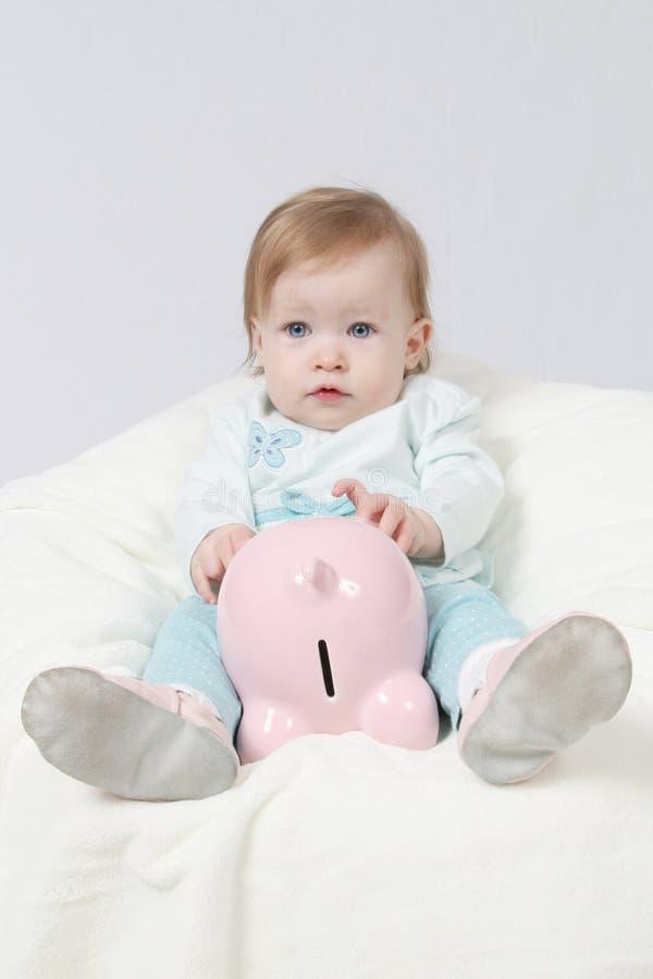 Baby and piggy bank stock photos