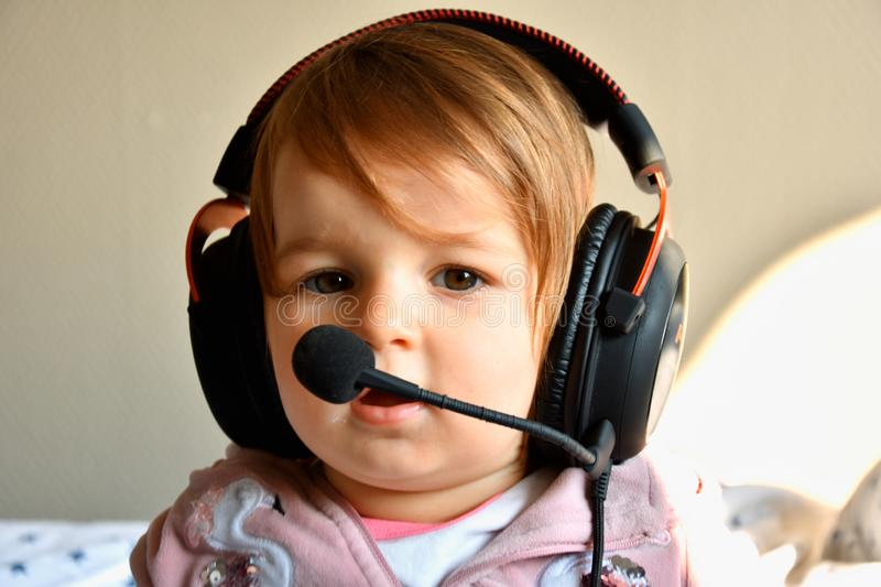 Baby pilot with headphones royalty free stock image
