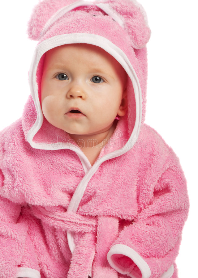 Baby in pink bathrobe. Isolated stock images