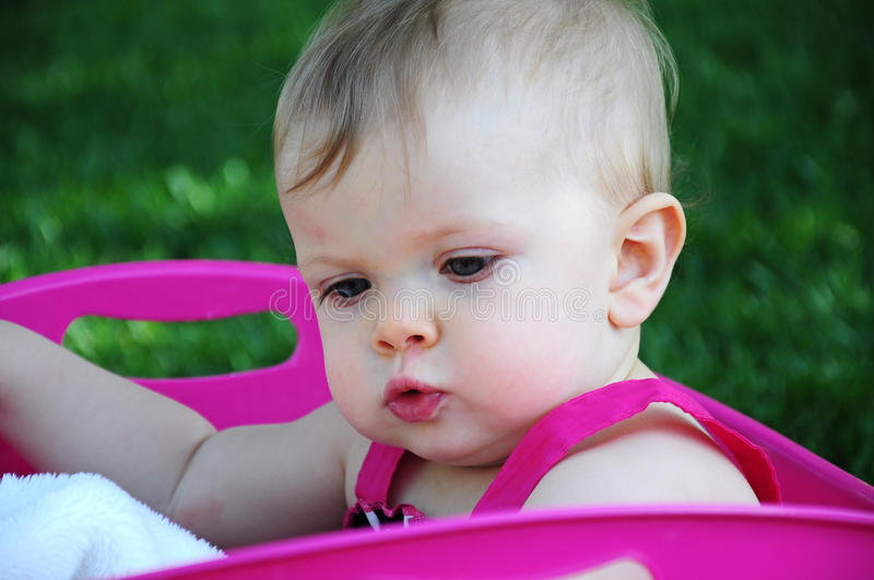 Baby In Pink Tub Stock Images