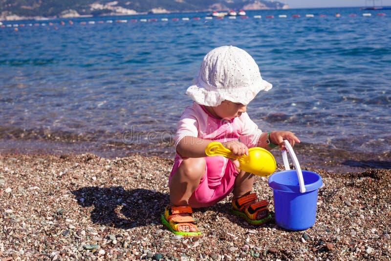 Baby play on seashore royalty free stock photo