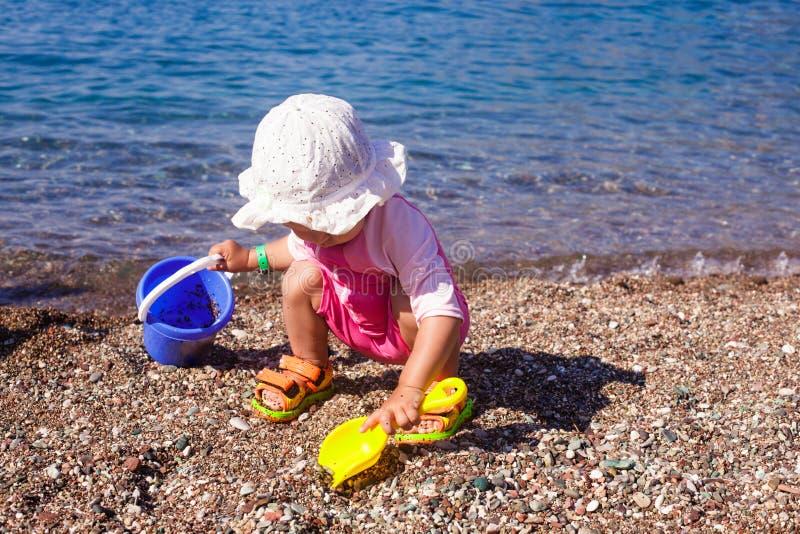 Baby play on seashore stock image