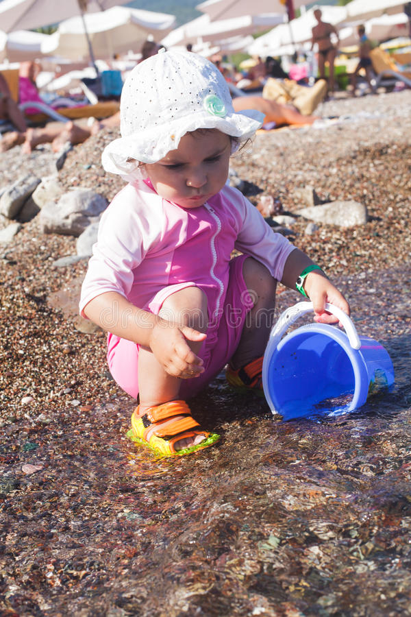 Baby play on seashore royalty free stock images