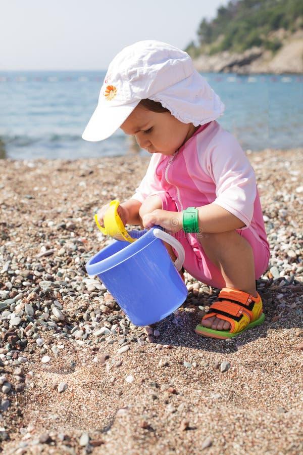 Baby play on seashore royalty free stock photography