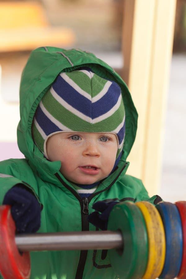 Baby in playground stock image