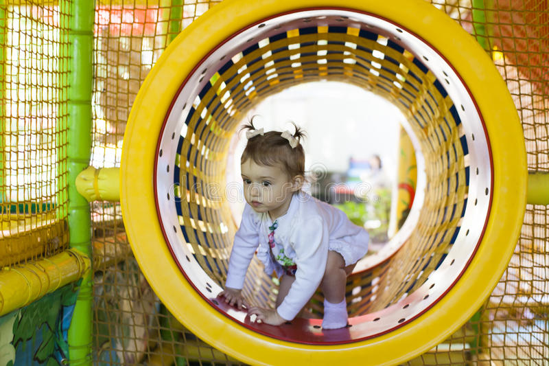 Baby on a playground stock photo