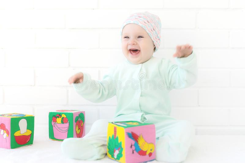 Baby playing with alphabet cube stock images