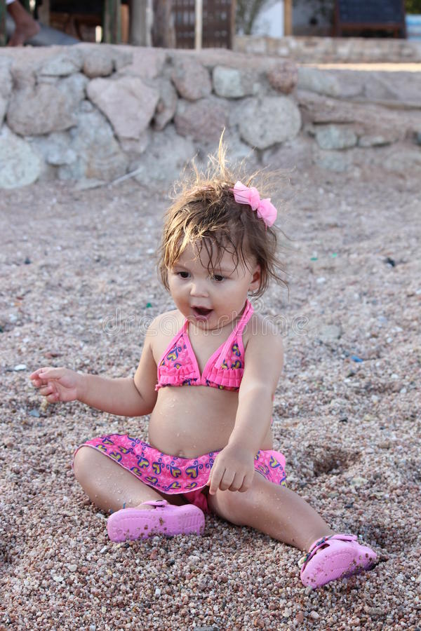 Baby playing on the beach. Baby girl playing on the beach.Taken at Sharm el Sheikh stock photo