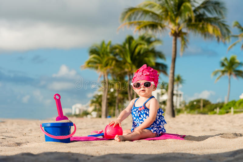 Baby Playing on Beach royalty free stock image