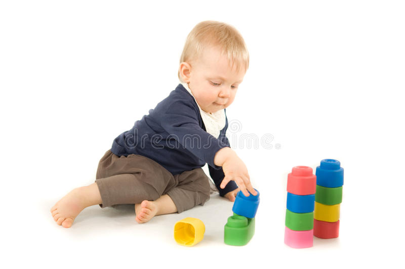 Baby playing with blocks on white background. Baby playing with blocks on white royalty free stock photos