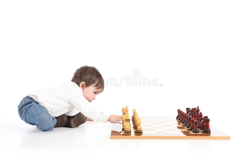 Baby playing chess stock image