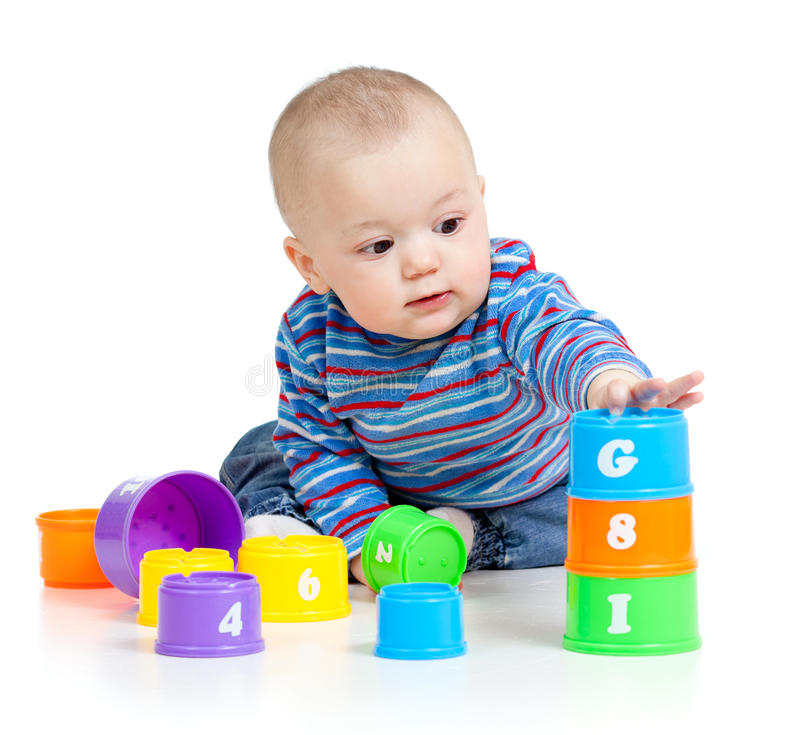 Baby playing with educational toys. Baby is playing with educational toys over white background royalty free stock images