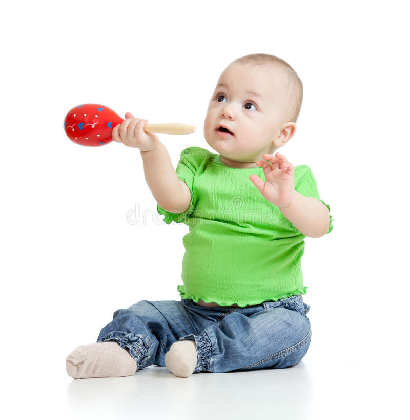 Baby playing with musical toy. Child playing with musical toy on white background royalty free stock photos