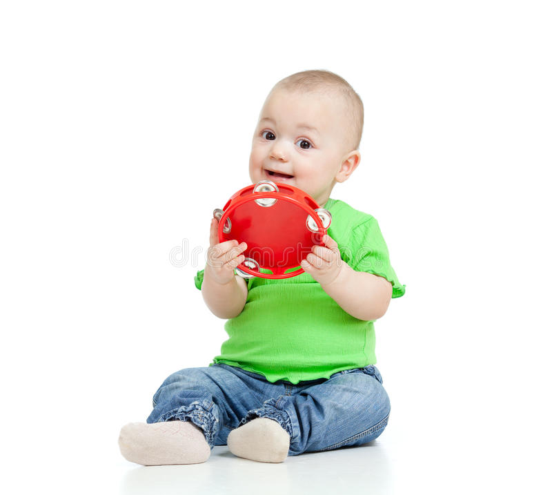 Baby playing with musical toy on white. Child playing with musical toy on white background stock images