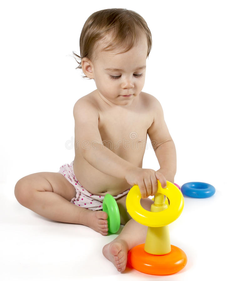 Game Toys To Practice : Baby playing with rings toy stock photo image