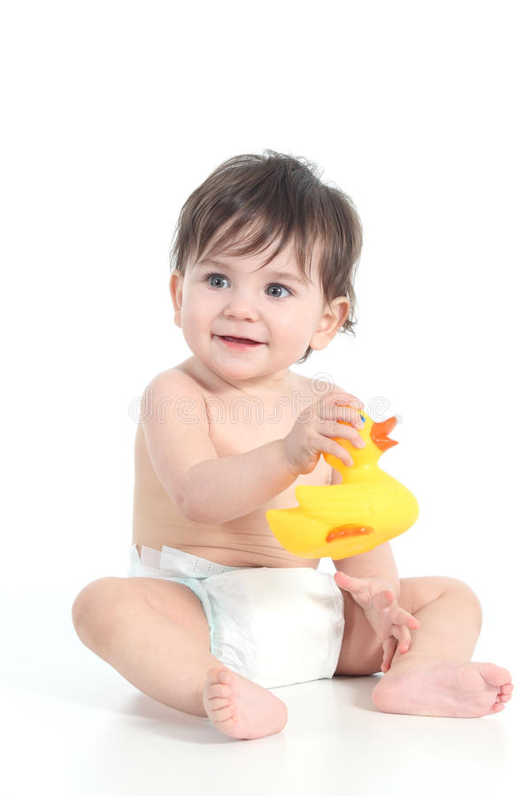 Baby playing with a rubber ducky royalty free stock image