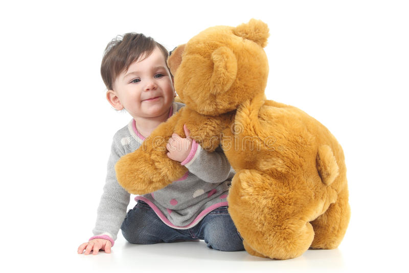 Baby playing with a teddy bear stock photos