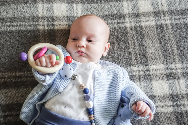 Baby playing with toy royalty free stock photo