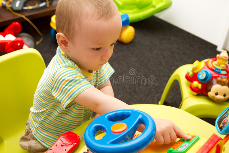 Baby Playing With The Toys stock images