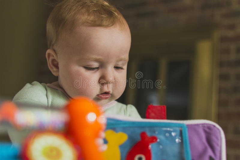 Baby playing with toys royalty free stock images