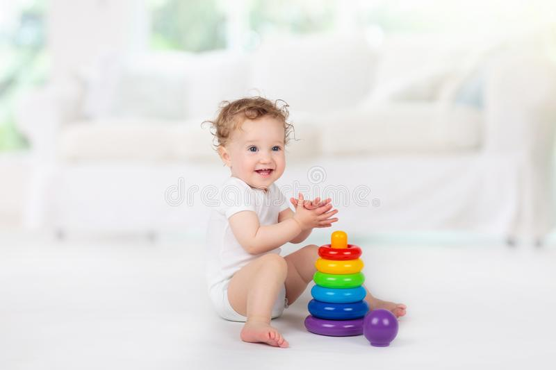 Baby playing with toys. Toy for child. Kids play stock photo