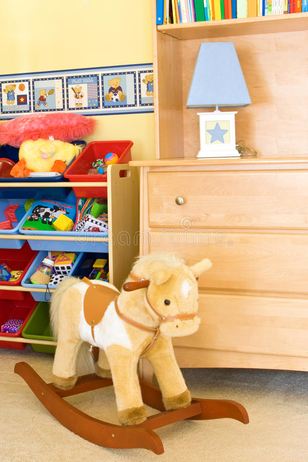 Baby playroom. Cozy baby playroom with toys royalty free stock image