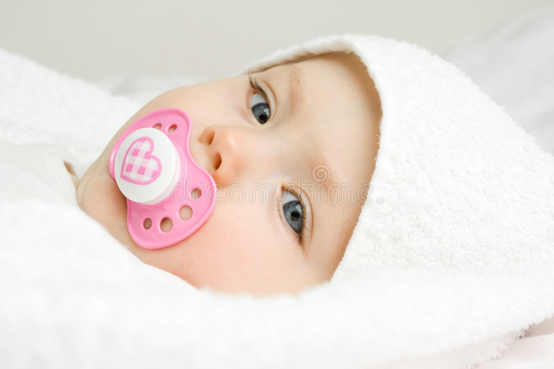 Baby portrait. A cute face of a baby covered with soft, white towel stock photos