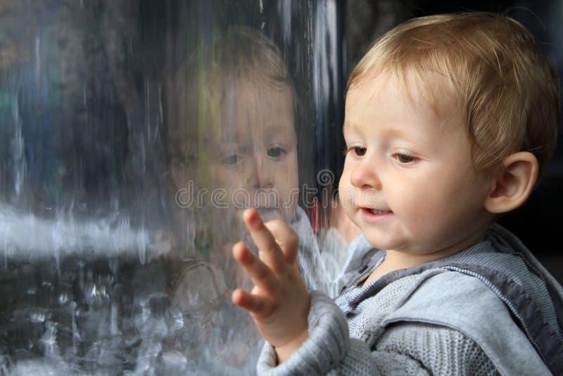 Baby portrait reflecting royalty free stock photos